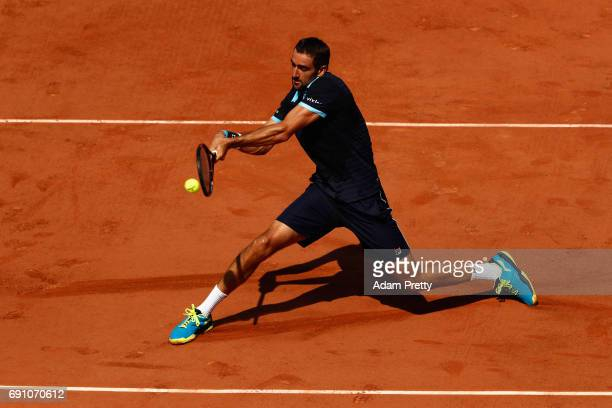 Marin Cilic of Croatia stretches to play a shot during the mens singles second round match against Konstantin Krachanov of Russia on day five of the...