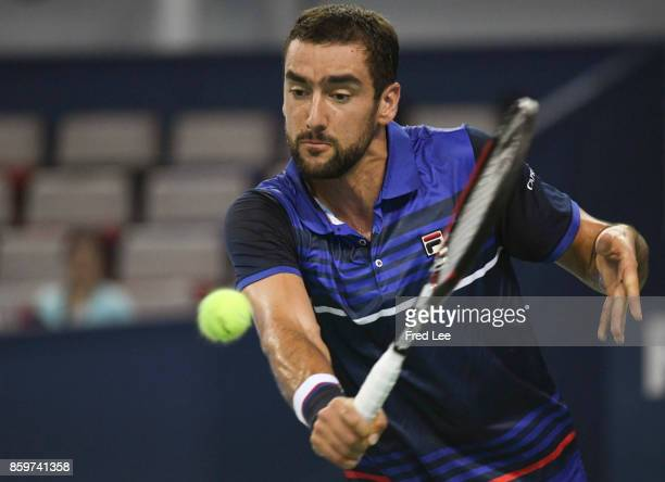 Marin Cilic of Croatia volleys during the Men's singles match against Kyle Edmund of Great Britain on day three of the Shanghai Rolex Masters at Qi...