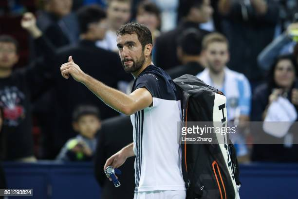 Marin Cilic of Croatia waves to the audience after losing the Men's singles semifinal match against Rafael Nadal of Spain on day seven of 2017 ATP...