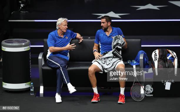 Marin Cilic of Team Europe talks with Bjorn Borg Captain of Team Europe during his singles match against John Isner of Team World on the first day of...