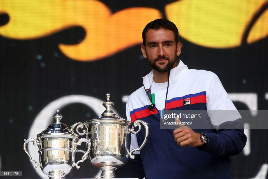 Marin Cilic poses for a photo with the trophies during the US Open Draw Ceremony at the Seaport District during US Open Fan Week in Manhattan, New York, United States on August 25, 2017.