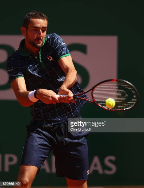 Marin Cillic of Croatia plays a backhand against Tomas Berdych of the Czech Republic in his third round match on day five of the Monte Carlo Rolex...