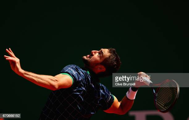 Marin Cillic of Croatia serves against Tomas Berdych of the Czech Republic in his third round match on day five of the Monte Carlo Rolex Masters at...