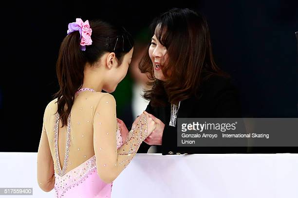 Marin Honda from Japan clashes hands with her coach prior to start her show during the Ladie's short program of the ISU World Junior Figure Skating...