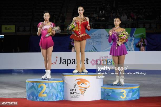 Marin Honda of Japan Alina Zagitova of Russia and Kaori Sakamoto of Japan pose on the podium in the medal ceremony for the Junior Ladies Free Skating...
