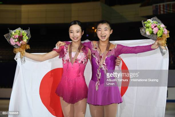Marin Honda of Japan and Kaori Sakamoto of Japan pose with their medals during the 4th day of the World Junior Figure Skating Championships at Taipei...