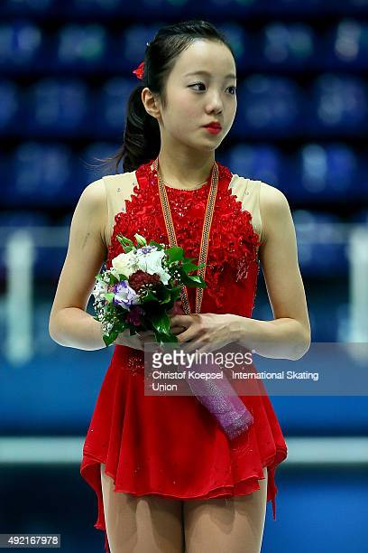 Marin Honda of Japan hears the national anthem during the medal ceremony of the junior ladies free skating of the ISU Junior Grand Prix at Dom...