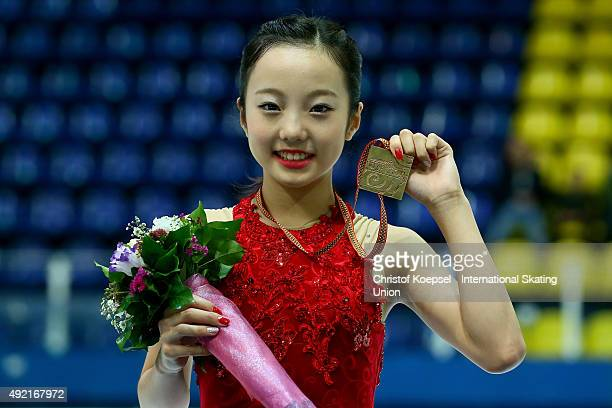 Marin Honda of Japan presents her gold medal during the medal ceremony of the junior ladies free skating of the ISU Junior Grand Prix at Dom Sportova...