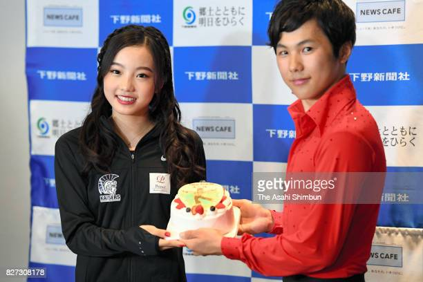 Marin Honda presents a birthday cake for her elder brother Taichi after the Prince Ice World 2017 in Nikko at Nikko Kirifuri Ice Arena on August 5...