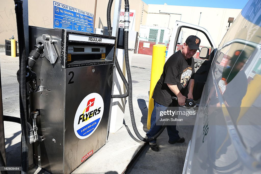 Marin Sun Farms driver Raye Miller pumps gas into his work truck on March 1, 2013 in San Francisco, California. The California Board of Equalization voted on Thursday to implement a statewide excise tax on gasoline starting July 1 that will increase the tax by 3.5 cents to 39.5 cents per gallon.