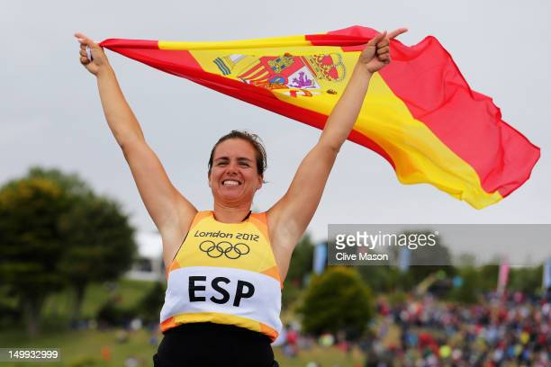 Marina Alabau Neira of Spain celebrates winning the gold medal in the RSX Women's Sailing on Day 11 of the London 2012 Olympic Games at the Weymouth...