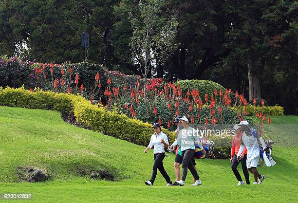 Marina Alex of the USA Mariajo Uribe of Colombia and Jing Yan of China walk down the 18th fairway during the final round of the Citibanamex Lorena...