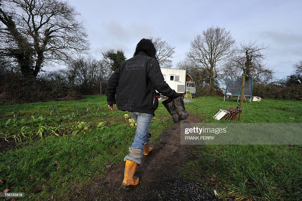 Marina, an activist who opposes the new airport project in Notre-Dame des Landes, walks back to her caravan at a makeshift camp built by activists and protesters called 'La Rolandiere', on December 21, 2012, in Notre-Dame des Landes. A wide range of local residents have joined activists in calling for an end to the Notre-Dame-des-Landes airport project near Nantes, in north-eastern France, saying the project will have a negative impact on the region, from an economic, environmental, and social standpoint.