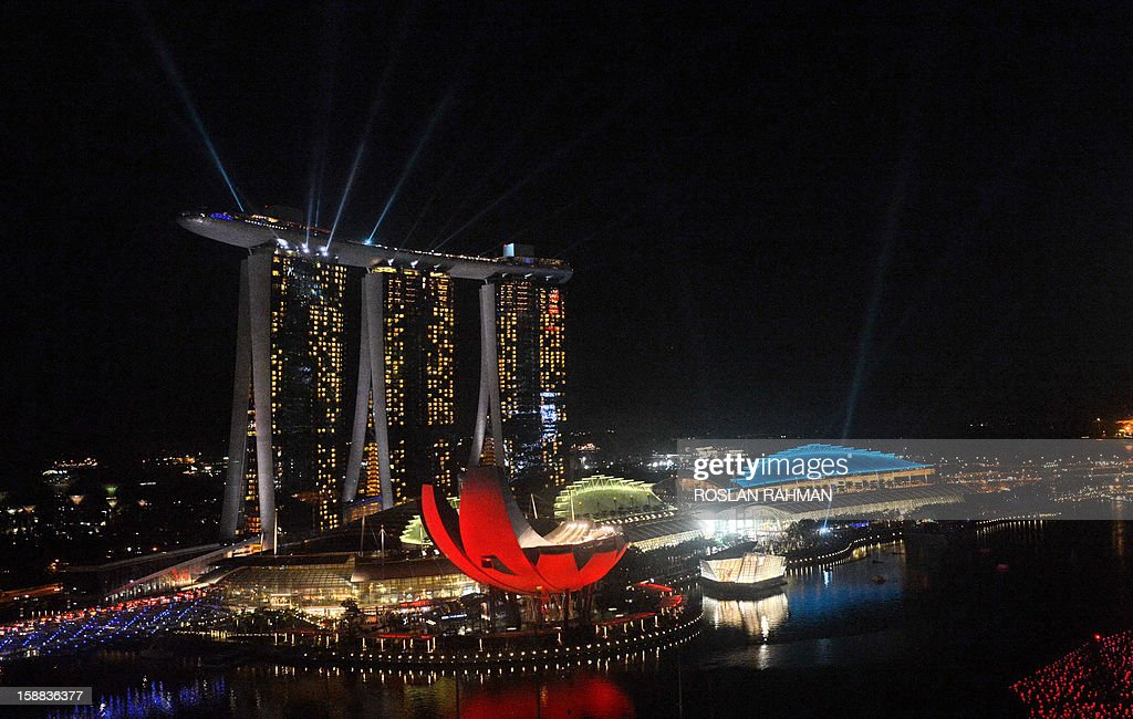 Marina Bay Sands hotel and resort are illuminated with colourful lights to usher the new year in Singapore on December 31, 2012. Ten of thousand people waited to watch the eight minutes display spectacular fireworks which burst across the bay.