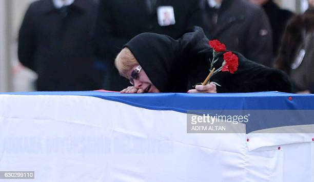 Marina Davydova Karlova widow of late Russian Ambassador to Turkey Andrei Karlov reacts in front of his coffin during a ceremonial farewell with full...