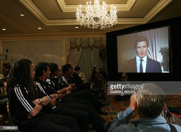 Los Angeles Galaxy soccer players listen to British soccer star David Beckham during a press conference live via satellite from Madrid 12 January...