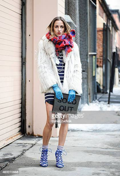 Marina Dobreva is seen outside the Honor show wearing a J Crew dress vintage fur Zara heels and a Sold Out clutch on February 12 2015 in New York City