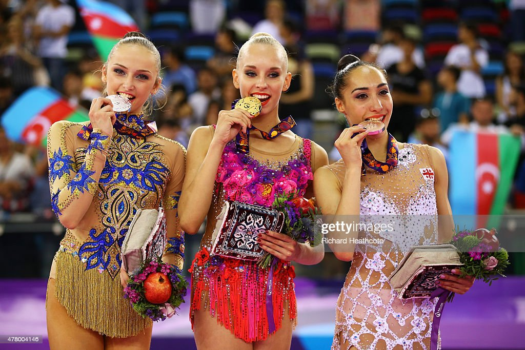 Marina Durunda of Azerbaijan Yana Kudryavtseva of Russia and Salome Pazhava of Georgia celebrate with their medals after the Rhythmic Gymnastics...
