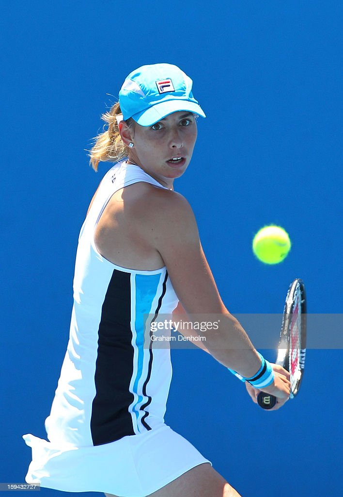 Marina Erakovic of New Zealand plays a backhand in her first round match against Alize Cornet of France during day one of the 2013 Australian Open at Melbourne Park on January 14, 2013 in Melbourne, Australia.