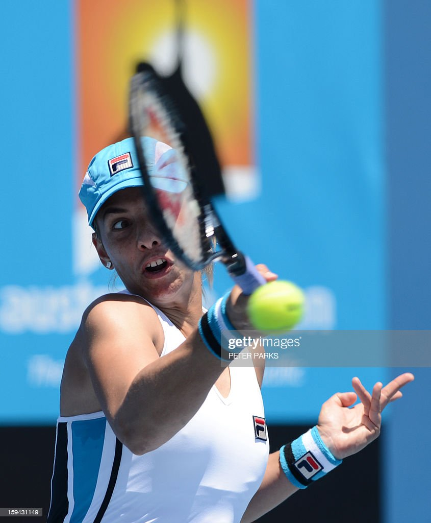 Marina Erakovic of New Zealand plays a return to France's Alize Cornet during their women's singles match on the first day of the Australian Open tennis tournament in Melbourne on January 14, 2013.