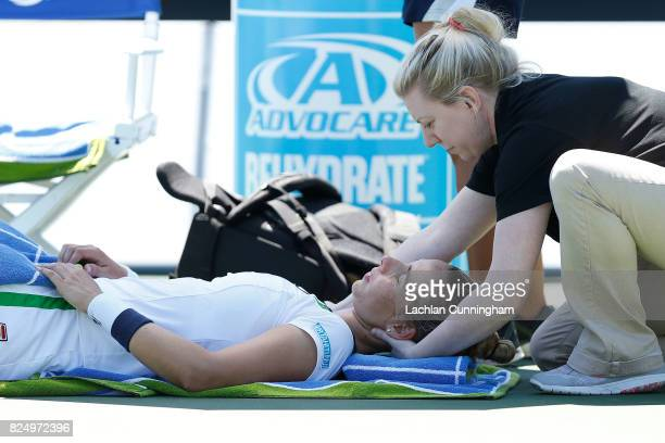 Marina Erakovic of New Zealand receives treatment between sets of her match against Ana Konjuh of Croatia during day 1 of the Bank of the West...