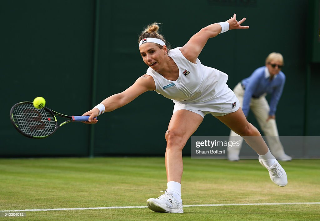 <a gi-track='captionPersonalityLinkClicked' href=/galleries/search?phrase=Marina+Erakovic&family=editorial&specificpeople=2229236 ng-click='$event.stopPropagation()'>Marina Erakovic</a> of New Zealand stretches to hit a forehand during the Ladies Singles first round match against Irina Falconi of the United States on day one of the Wimbledon Lawn Tennis Championships at the All England Lawn Tennis and Croquet Club on June 27th, 2016 in London, England.