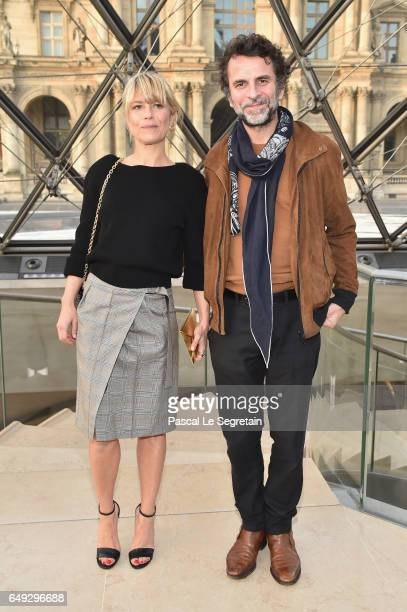 Marina Fois and Eric Lartigau attend the Louis Vuitton show as part of the Paris Fashion Week Womenswear Fall/Winter 2017/2018 on March 7 2017 in...