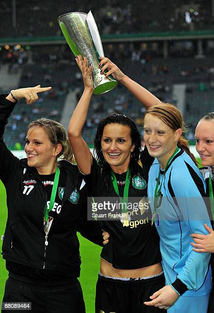 Marina Hegering Fatmire Bjaramaj and Kathrin Laenge of Dusiburg after the DFB Women's Cup Final between FCR Duisburg and Turbine Potsdam on May 30...