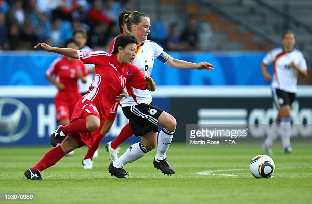 Marina Hegering of Germany and Mi Gyong Choe of North Korea compete for the ball during the FIFA U20 Women's World Cup Quarter Final match between...