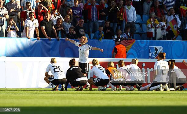 Marina Hegering of Germany celebrates with her team mates after winning the FIFA U20 Women's World Cup Quarter Final match between Germany and North...