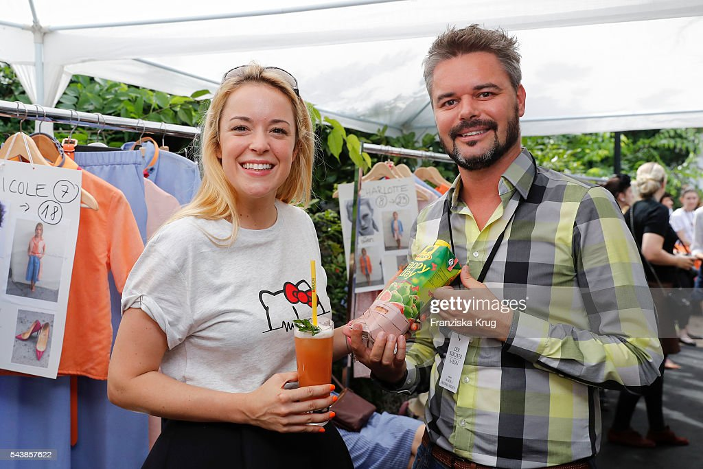 Marina Hoermanseder and Herbert Pretterhofer, Rauch Interntional Marketing Manager attend the presentation of the Rauch Happy Day Limited Edition designed by Marina Hoermanseder ahead of the Marina Hoermanseder defilee during the Der Berliner Mode Salon Spring/Summer 2017 at Kronprinzenpalais on June 30, 2016 in Berlin, Germany.