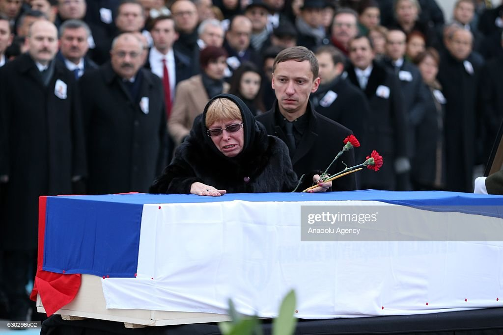 Marina Karlov (C), widow of deceased Russian ambassador to Turkey Andrei Karlov mourns over his husband's coffin as she attend the farewell ceremony that organized for Andrei Karlov at Esenboga International Airport in Ankara, Turkey on December 20, 2016. Russian Ambassador to Turkey Andrei Karlov has been shot multiple times at an exhibition in Ankara and died, on December 19, 2016. Karlov was delivering a speech at the opening ceremony of a photo exhibit when an armed assailant 22-year-old riot police officer Mevlut Mert Altintas opened fire on him. Assailant has been killed during the fire exchange at the crime scene.