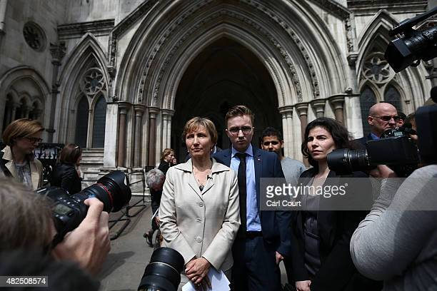 Marina Litvinenko the widow of Alexander Litvinenko is accompanied by their son Anatoly as she addresses the media outside the High Court on July 31...