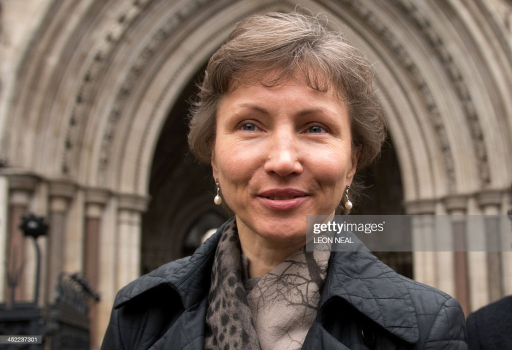 Marina Litvinenko, the widow of former Russian agent Alexander Litvinenko, leaves the High Court in central London on November 27, 2013. The Government has won the legal right to keep secret documents linked to the proposed inquest into the death of the former KGB spy Alexander Litvinenko.The 43-year-old dissident agent was poisoned with radioactive polonium-210 while drinking tea at a London hotel in 2006.