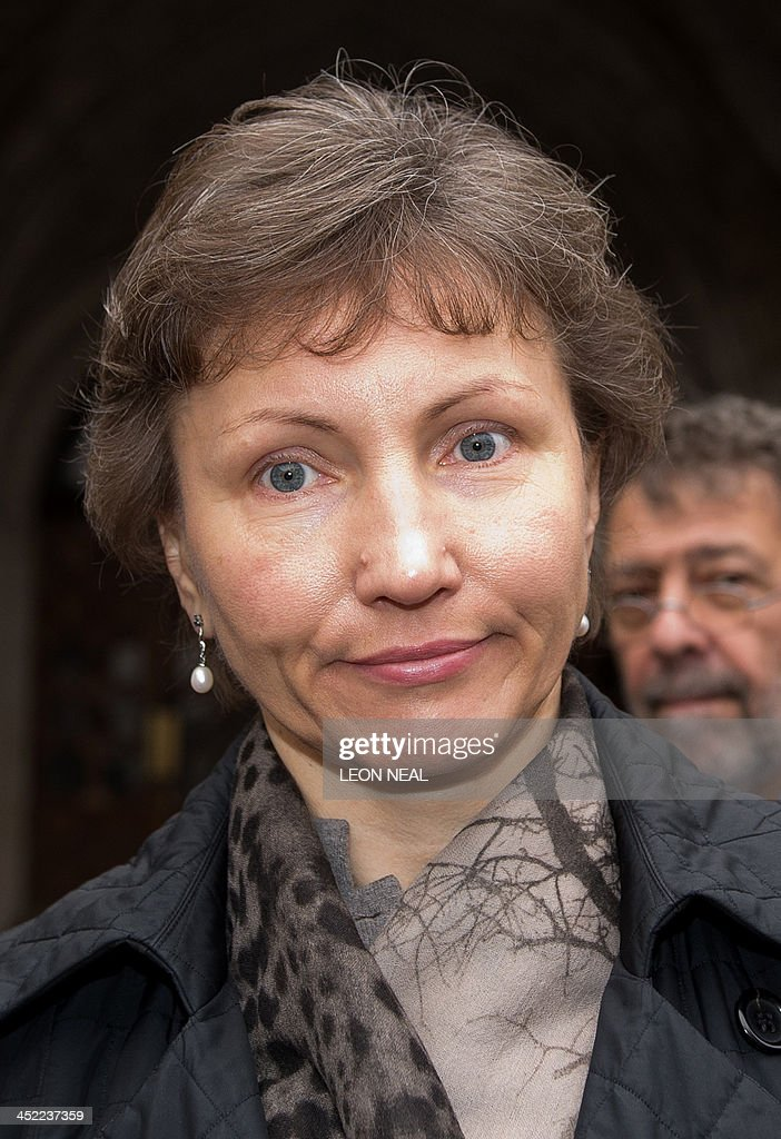 Marina Litvinenko, the widow of former Russian agent Alexander Litvinenko, leaves the High Court in central London on November 27, 2013. The Government has won the legal right to keep secret documents linked to the proposed inquest into the death of the former KGB spy Alexander Litvinenko.The 43-year-old dissident agent was poisoned with radioactive polonium-210 while drinking tea at a London hotel in 2006. AFP PHOTO / LEON NEAL