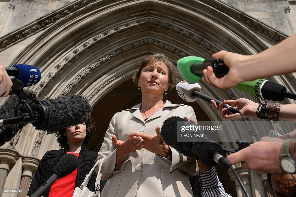 Marina Litvinenko, the widow of Russian former spy Alexander Litvinenko, speaks to the media outside the High Court in central London, on July 31, 2014. Britain on Thursday formally opened an inquiry into the radioactive poisoning of Russian former spy Alexander Litvinenko in a case that threatens to increase tensions with Moscow amid the crisis in Ukraine.