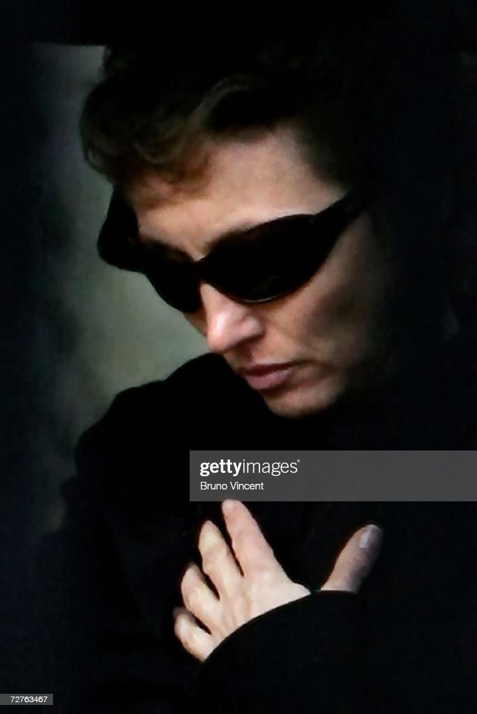 Marina Litvinenko the wife of poisoned former Russian KGB spy Alexander Litvinenko walks through Highgate Cemetary after his funeral on December 7, 2006 in London, England. Litvinenko's death on November 23, has been linked to polonium 210. Scotland Yard are treating the case as murder whilst detectives are continue their inquiries in Moscow.