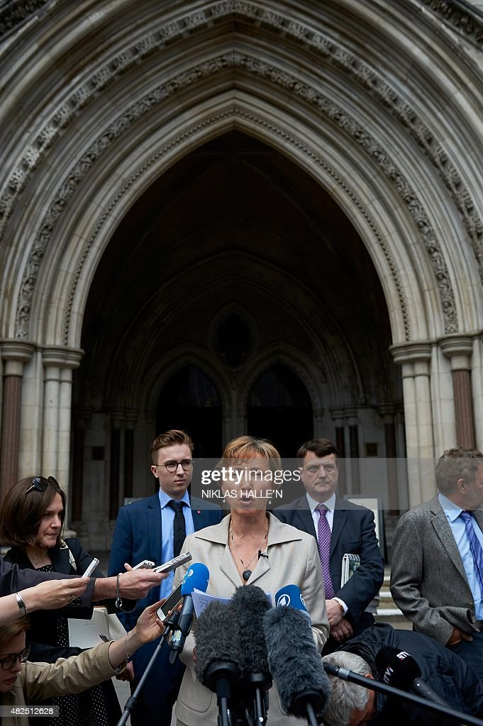 Marina Litvinenko widow of Russian former spy Alexander Litvinenko speaks to members of the media outside the Royal Courts of Justice in central...