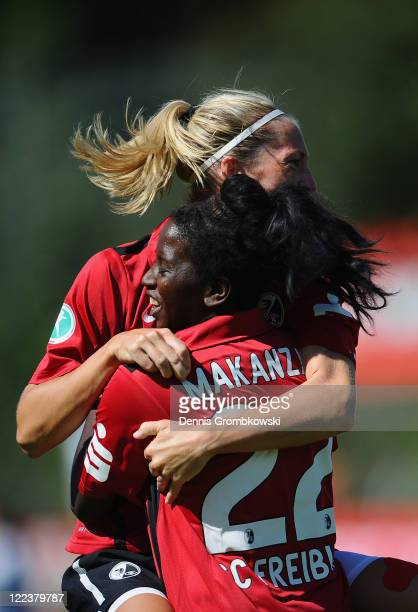 Marina Makanza of Freiburg celebrates with team mate Kerstin Boschert after scoring her team's third goal during the Women's Bundesliga match between...