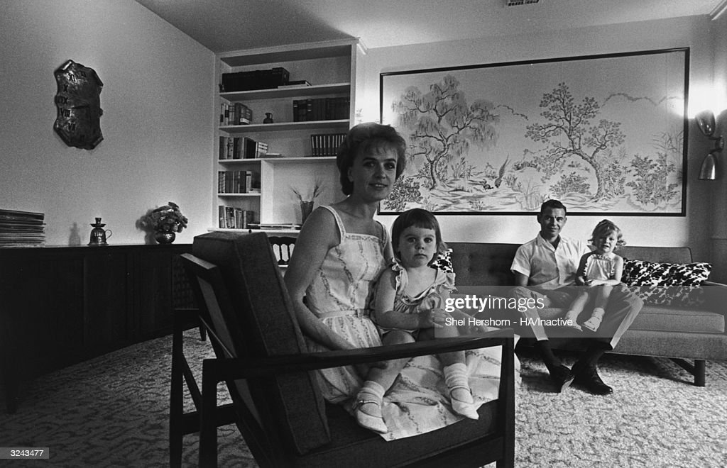 Marina Oswald Porter, former wife of Lee Harvey Oswald, accused assassin of President John F Kennedy, sits in her living room with her second husband, Kenneth Porter, and their two daughters, Texas.