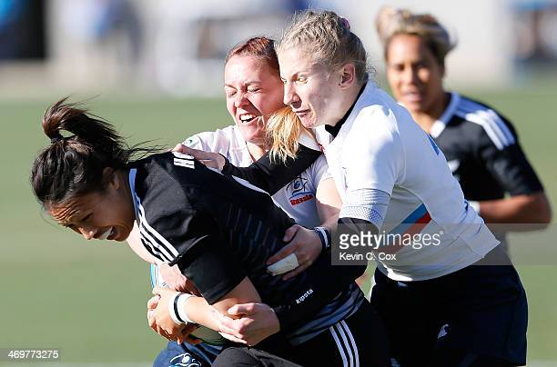 Marina Petrova and Anna Prib of Russia tackle Carla Hohepa of New Zealand during the Women's Sevens World Series at Fifth Third Bank Stadium on...