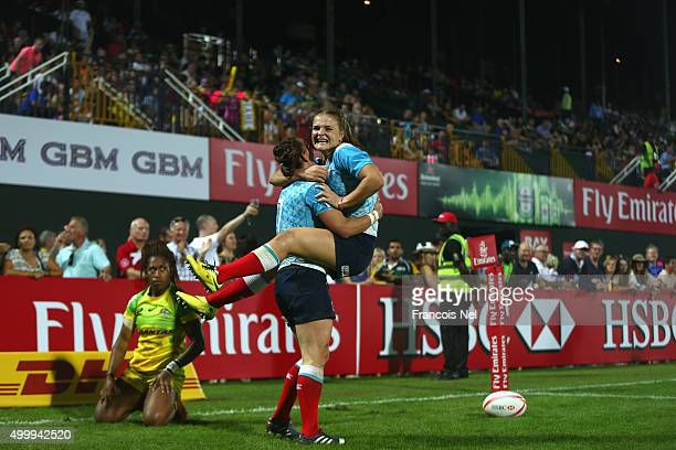 Marina Petrova is congratulated by team mate Alena Mikhaltsova of Russia after scoring a try against Australia during the Emirates Dubai Rugby Sevens...