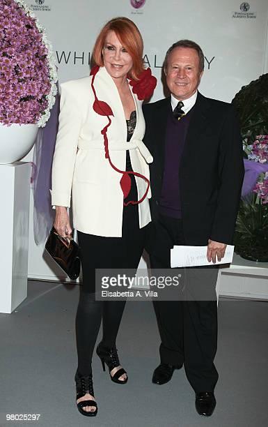 Marina Ripa Di Meana and Sergio Valente attend 'L'Arte Nell'Uovo Di Pasqua' Charity Event at the White Gallery on March 24 2010 in Rome Italy