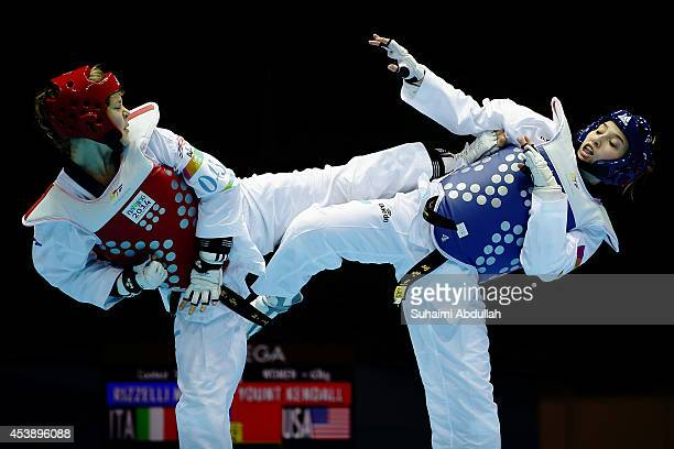 Marina Rizelli of Italy and Kendall Yount of United States of America compete in the taekwondo women 63kg Round of 16 on day five of the Nanjing 2014...