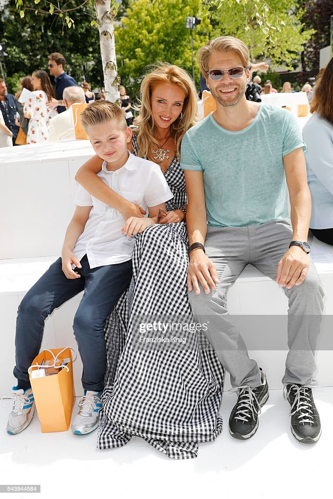 Marina Rudolph, Kai Rose and their son attend the presentation of the Rauch Happy Day Limited Edition designed by Marina Hoermanseder ahead of the Marina Hoermanseder defilee during the Der Berliner Mode Salon Spring/Summer 2017 at Kronprinzenpalais on June 30, 2016 in Berlin, Germany.