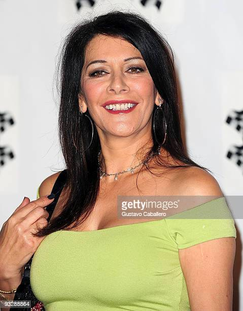 Marina Sirtis arrives at The Rally for Kids with Cancer Celebrity Draft Party on November 20 2009 in Miami Beach Florida