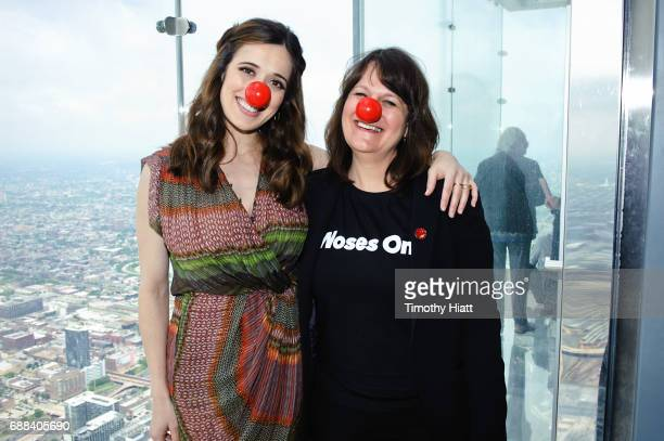 Marina Squerciati and Beth Breslauer light Willis Tower in honor of Red Nose Day at Willis Towerat Willis Tower on May 25 2017 in Chicago Illinois