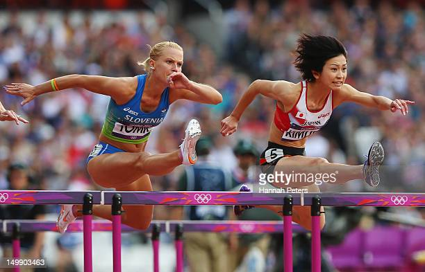 Marina Tomic of Slovenia and Ayako Kimura of Japan compete in the Women's 100m Hurdles heat on Day 10 of the London 2012 Olympic Games at the Olympic...