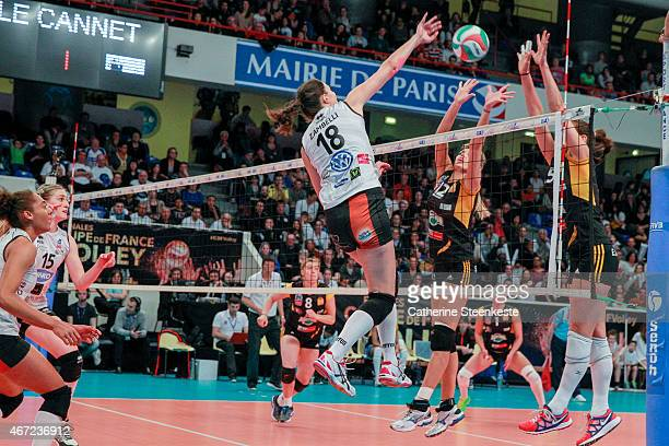 Marina Zambelli of ES Le CannetRocheville VB spikes the ball as Victoria Ravva and Logan Tom of RC Cannes block during the Women's Finale of La Coupe...