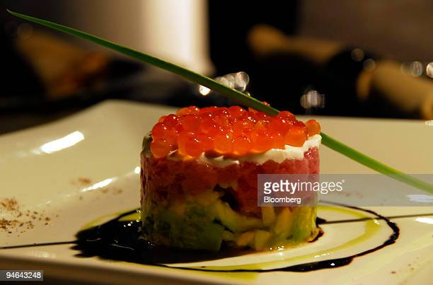 Marinated tuna tartar on avocado tomato and sour cream topped with salmon roe at the Vertigo rooftop restaurant on the 61st floor of the Banyan Tree...